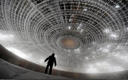 a-man-walks-inside-the-crumbling-skeleton-of-the-house-of-the-bulgarian-communist-party-on-mount-buzludzha-bulgaria-getty-images